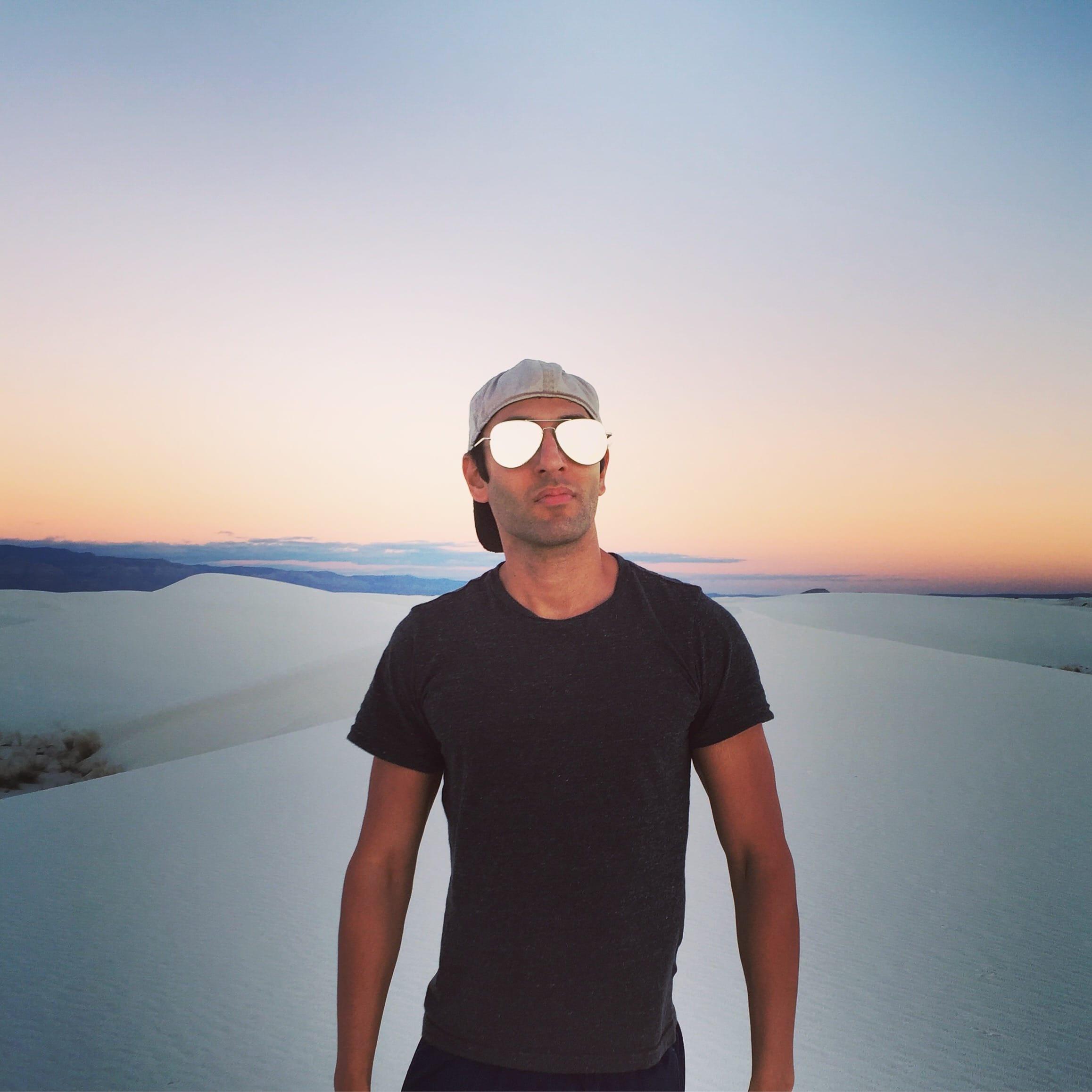 Chris Vij standing on white sand beach